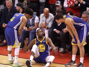 Kevin Durant of the Golden State Warriors reacts after sustaining an injury during the second quarter against the Toronto Raptors during Game Five of the 2019 NBA Finals at Scotiabank Arena on June 10, 2019 in Toronto.