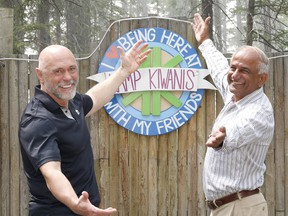 Grant Kelba, President of the Calgary Downtown Kiwanis Club, joins Mike Shaikh, the former president of the Calgary Kiwanis Club, to pose for a photo at Kamp Kiwanis. This month the Calgary Kiwanis Club is celebrating 100 years of service in Calgary and it's surrounding communities. Friday, May 31, 2019. Brendan Miller/Postmedia