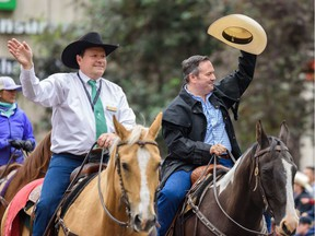 Premier Jason Kenny, right, and Calgary Stampede President Dana Peers proceed down 9 avenue during the 2019 Calgary Stampede Parade on Friday, July 5, 2019. Azin Ghaffari/Postmedia Calgary