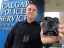 Calgary Police Service Staff Sgt. Travis Baker shows the service's new Axon body camera on July 3, 2018.