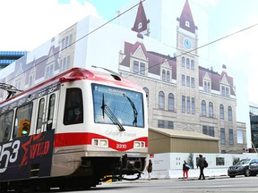 A Calgary Transit train passes by City Hall on 7 Ave in downtown Calgary on Tuesday, July 16, 2019.