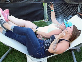 Faye Horvath and Chelsey Coulson are smoking in the cannabis consumption area during the 40th Annual Calgary Folk Music Festival at Prince's Island Park on Thursday, July 25, 2019.