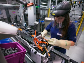 An employee assembles lithium-ion battery modules at the Bayerische Motoren Werke AG (BMW) automobile manufacturing plant in Dingolfing, Germany. An Alberta company is developing a way to process lithium from oilfield brine, says columnist Danielle Smith.