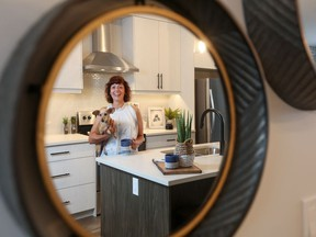 Laura Brodie, with her pooch Stella, loves the no-maintenance her new home at Arrive at D'Arcy Blvd.