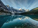 Moraine Lake reflection on a calm morning in Banff National Park, Alberta, in the heart of the Canadian Rockies.