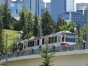 A CTrain rolls northwest out of downtown Calgary.