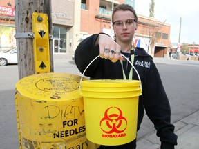 Jacqueline Jerram, an outreach worker with Alpha House, is seen holding a bio hazard bucket as the Alpha House team has initiated proactive needle patrols downtown.