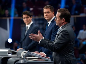 Canada's Prime Minister and Liberal leader Justin Trudeau (L), Conservative leader Andrew Scheer (C) and Bloc Quebecois leader Yves-Francois Blanchet take part in the the Federal leaders French language debate in Gatineau, Que. on Thursday, October 10, 2019.