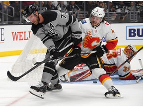 Oct 19, 2019; Los Angeles, CA, USA; Calgary Flames goaltender David Rittich (33) blocks a shot by Los Angeles Kings center Jeff Carter (77) as Calgary defenseman Rasmus Andersson (4) assists in the second period at Staples Center. Mandatory Credit: Jayne Kamin-Oncea-USA TODAY Sports ORG XMIT: USATSI-405115