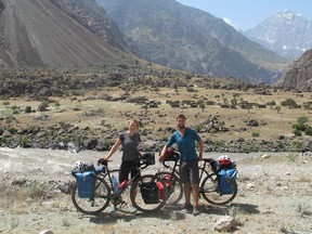 Trevor and Emily Gair with their bikes near the Panj River, which separates Tajikistan and Afghanistan. They cycled next to this river for 500 kilometres.