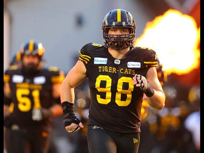 Hamilton Tiger-Cats Dylan Wynn runs onto the field during the 107th Grey Cup CFL championship football game in Calgary on Sunday, November 24, 2019. Al Charest/Postmedia
