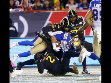Winnipeg Blue Bombers, Andrew Harris  is taken down by the Hamilton Tiger-Cats at McMahon stadium during the 107th Grey Cup in Calgary on Sunday, November 24, 2019. Darren Makowichuk/Postmedia