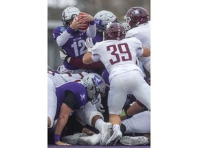 Western quarterback Chris Merchant tries to go over the pile but is stopped early in their Yates Cup game against the McMaster Marauders last Saturday at Western.  McMaster dominated the game winning 29-15. Photo by Mike Hensen/Postmedia.