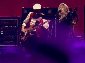 John McVie and Stevie Nicks perform with Fleetwood Mac at Rexall Place in Edmonton on Saturday, Nov. 15, 2014.