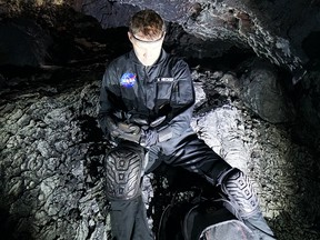 University of Calgary professor Kent Hecker tests the MUSE headband inside a lava tube at Mauna Loa, Hawaii.