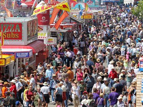 Crowds enjoy the warm weather at the  Calgary Stampede in Calgary, Alberta on July 7, 2012.