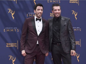 Drew Scott, left, and Jonathan Scott arrive at night two of the Creative Arts Emmy Awards at The Microsoft Theater on Sunday, Sept. 9, 2018, in Los Angeles.