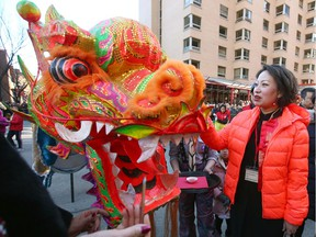 Lu Xu, the Consulate General of the People's Republic of China, participates during the Chinese New Year celebrations in downtown Calgary on Saturday, January 25, 2020. Jim Wells/Postmedia
