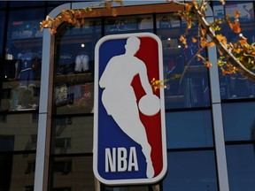 FILE PHOTO: An NBA logo is seen on the facade of its flagship store at the Wangfujing shopping street in Beijing, China October 8, 2019.