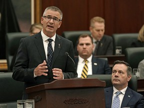 Travis Toews (Alberta Minister of Finance and President of the Treasury Board) delivers his provincial budget speech at the Alberta Legislature in Edmonton on Thursday February 27, 2020, as Alberta Premier Jason Kenney (right) looks on. (PHOTO BY LARRY WONG/POSTMEDIA)