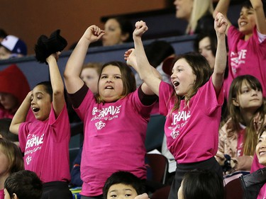 School children cheer on the Calgary Hitmen as they take on the Winnipeg Ice during the TELUS Be Brave #endbullying game on Thursday, February 27, 2020. The Hitmen won the game 4-1. Gavin Young/Postmedia