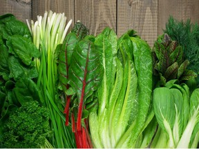 Spring vitamin set of various green leafy vegetables on rustic wooden table. Getty Images/iStock Photo