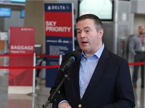 Premier Jason Kenney speaks with media at the Calgary International Airport on Wednesday, March 11, 2020.  Gavin Young/Postmedia
