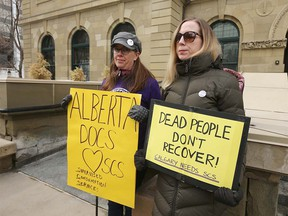 Bonnie Larson (L) and Rebecca Saah show their suppoert outside McDougall Centre in Calgary as the Government of Alberta released a report on safe consumption sites in Alberta during a press conference in Calgary on Thursday, March 5, 2020. Jim Wells/Postmeda