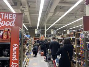 There were long lines at grocery stores last night. Photo by Alanna Smith.