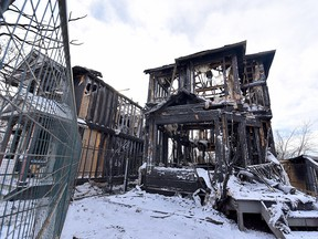 Two homes were destroyed by fire in the 2400 block of Riverstone Road S.E. on Wednesday, March 4, 2020.