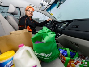 Rahul Kumar poses for a photo in his car filled with groceries on Friday, April 10, 2020. Azin Ghaffari/Postmedia