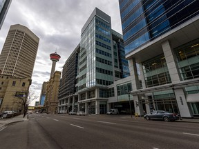 Pictured is a nearly deserted 9 Avenue S.W. in Downtown Calgary on Thursday, April 30, 2020. Azin Ghaffari/Postmedia