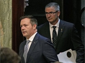 Jason Kenney, left, with Finance Minister Travis Toews, has joined a long list of free-spending premiers in Alberta. That chaos has to stop with a financial reset, says columnist Danielle Smith.