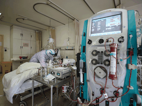A COVID-19 patient receives extra-corporeal membrane oxygenation (ECMO) treatment at the Red Cross hospital in Wuhan, China.