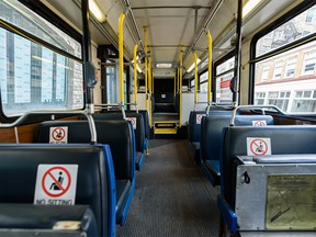 Photographed are seats inside a Calgary Transit bus that has been marked in order to implement physical distancing on Thursday, April 30, 2020.