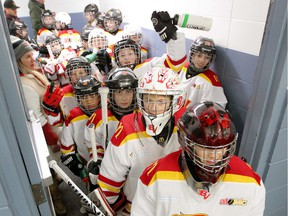 FILE - Members of the Atom 1 South Bow Valley Black team are seen cheering before they hit the ice at the Lake Bonavista arena during the 2019/2020 Esso Minor Hockey Week hosted by Hockey Calgary.