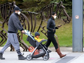 A steady flow of people enter the Calgary Zoo as it opened in Calgary on Saturday, May 23, 2020.