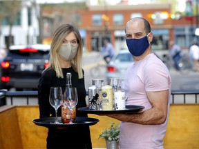Wine Bar Kensington and Container Bar owners, Cam Dobranski and wife, Jacq Warrell get ready to open up this week in Calgary on Sunday, May 24, 2020.