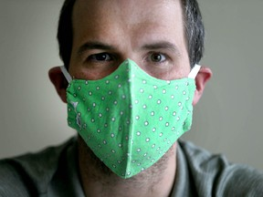 Rich Allan wears a Canadian Zodiac-manufactured mask on Friday, May 22, 2020. The clothing maker is shifting gears during the COVID-19 pandemic.