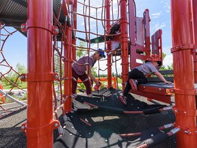 Schona Mrozek sanitizes the playground equipments for her two-year-old son Tyson to play in the playground in East Village on Friday, May 29, 2020.