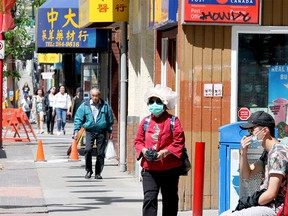 Crowded sidewalks are seen along Centre St. S in Chinatown. Monday, June 22, 2020.