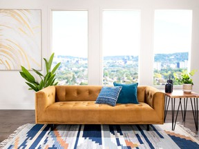 Refresh your home with light, bright colours, such as this couch by Structube.