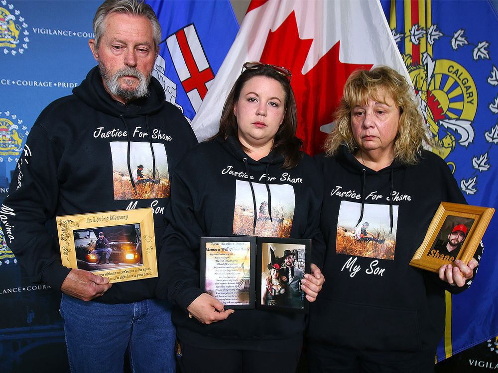 Bill (Father), Shirley (Mother) and Cassandra (Sister) Smith hold photos of Shane Eric James Smith, who was reported missing on Sunday June 7, 2020. The family is pleading for any information regarding his disappearance. Thursday, July 16, 2020.
