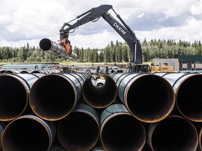 Pipe for the Trans Mountain pipeline is unloaded in Edson on June 18, 2019.