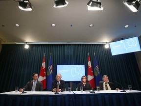 (L-R) Doug Schweitzer, Minister of Justice and Solicitor General, Jason Luan, Associate Minister of Mental Health, Geri Bemister-Williams, vice-chair, Supervised Consumption Services Review Committee and Rod Knecht, chair, Supervised Consumption Services Review Committee are shown as the Government of Alberta released a report on safe consumption sites in Alberta during a press conference in Calgary on Thursday, March 5, 2020.