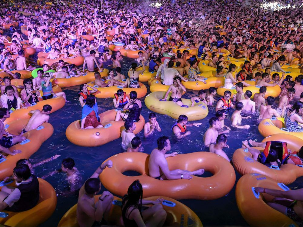 People pack together in a swimming pool at the Wuhan Maya Beach Water Park for a music festival in Wuhan in China's central Hubei province, August 15, 2020.