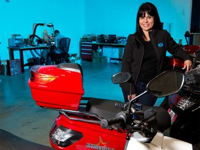 Sue Ozdemir, CEO of Exro Technologies Inc., stands with electric motor bikes in the company's Calgary facility on Wednesday, August 26, 2020. Exro Technologies has designed technology to improve the performance, efficiency, and longevity of batteries, electric motors and generators.