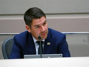 Councillor Evan Woolley listens as Calgary Police Chief Mark Neufeld answers questions in Calgary City Council Chambers on Thursday, September 10, 2020.