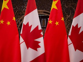 Canadian and Chinese flags are seen prior to a meeting between Prime Minister Justin Trudeau and Chinese President Xi Jinping at the Diaoyutai State Guesthouse in Beijing, in 2017.
