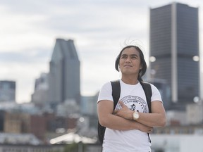 Resig Calanog, a sailor from the Philippines poses while on shore leave in the Old port of Montreal, Thursday, Sept. 3, 2020. Calanog's walk around Montreal's port is only the second time in nine months he's been on solid ground. Even for a career ship worker, it's a lot of time at sea. But as for when he'll be able to walk in his homeland in the Philippines, and see his three children, that remains uncertain.